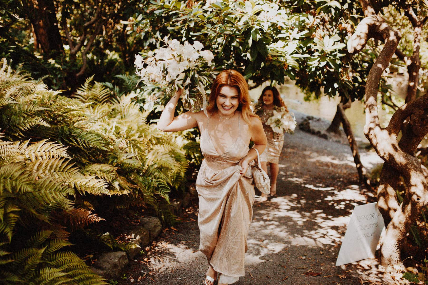 bridesmaids walking with bouquets