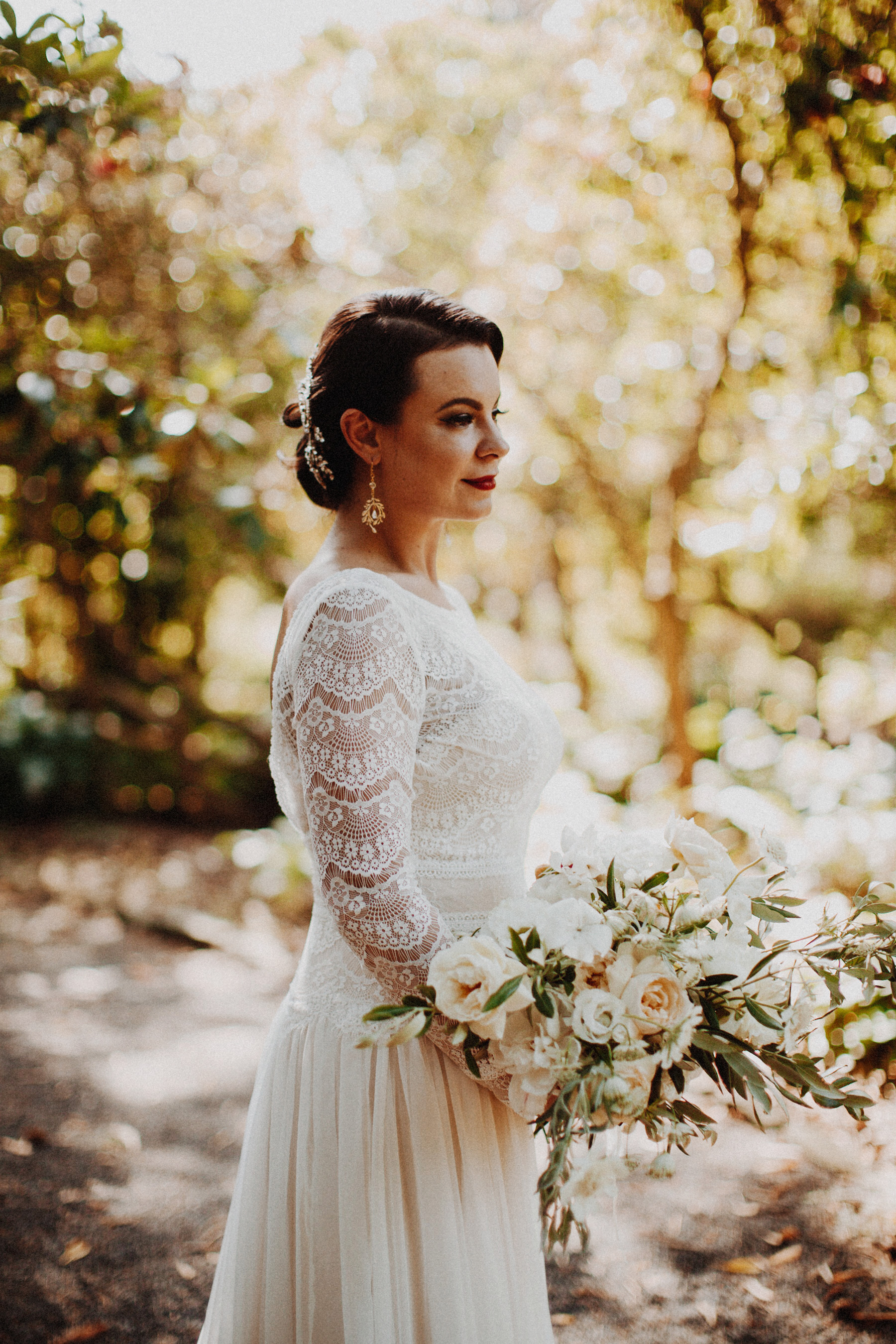 bride with bouquet in the forest