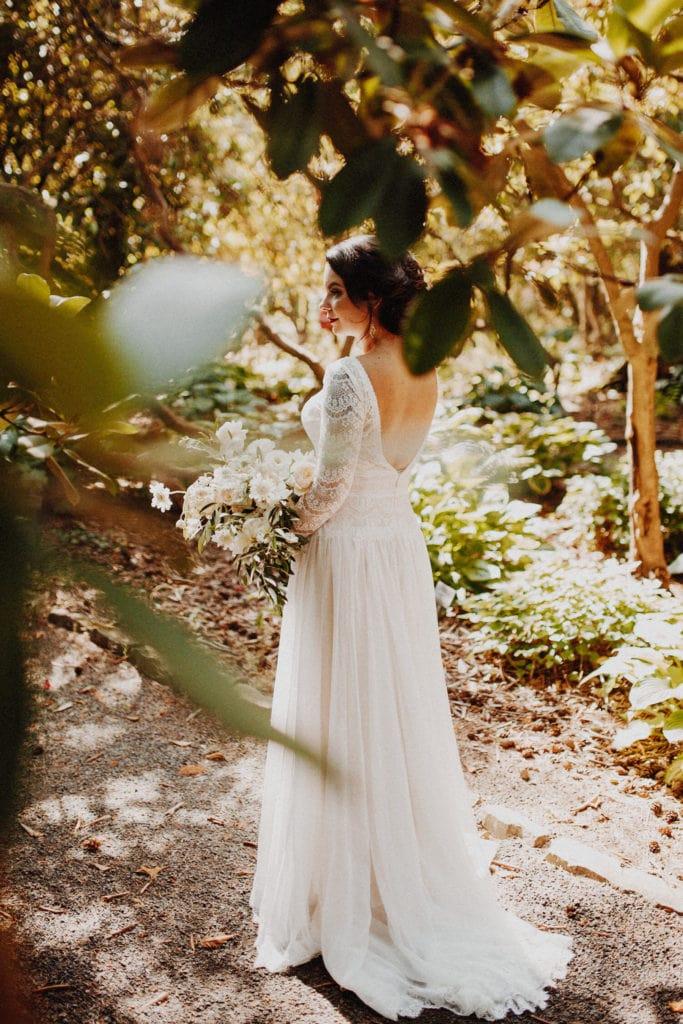 bride in the garden holding her bouquet