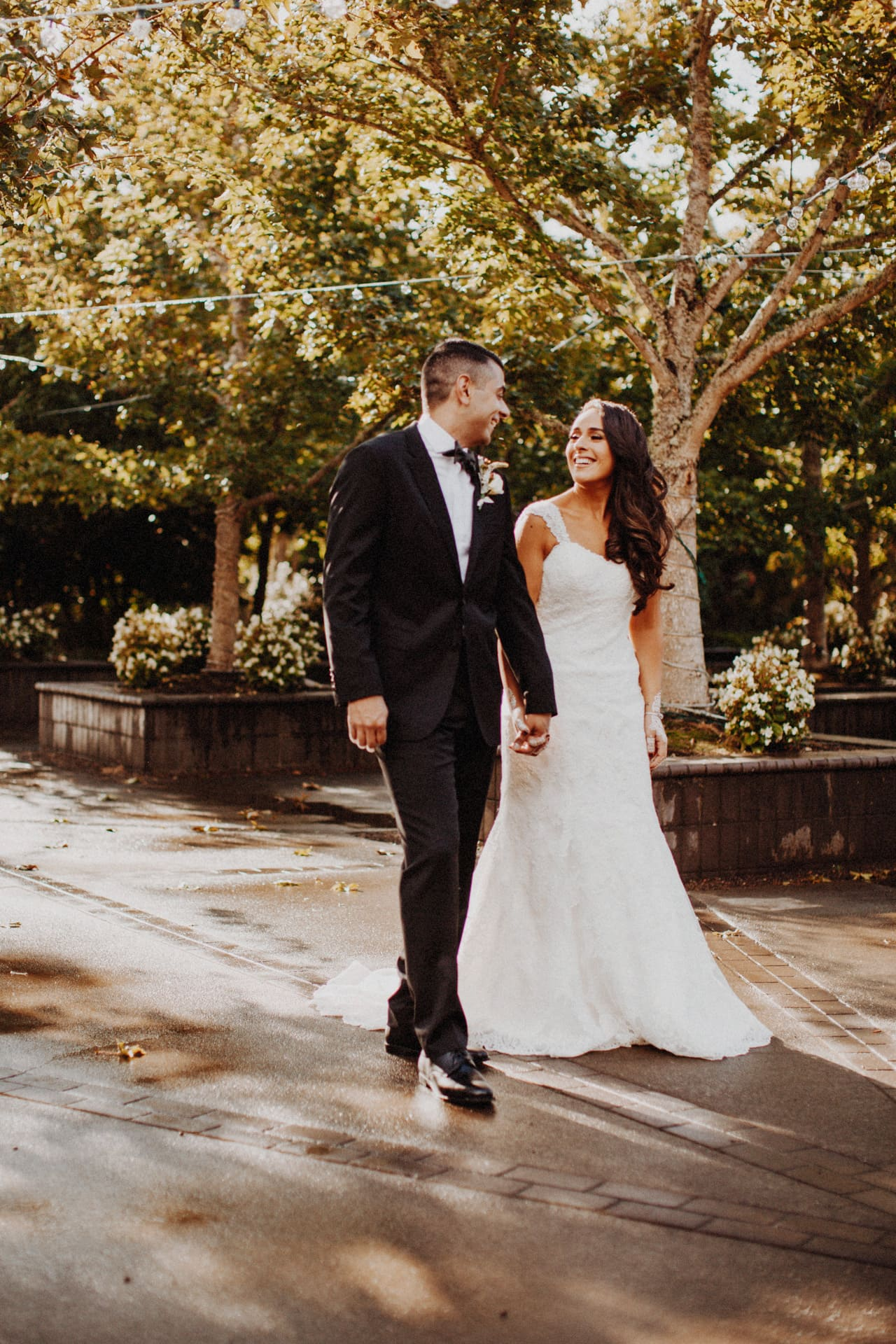the bride and groom walking through the oregon garden resort at their wedding