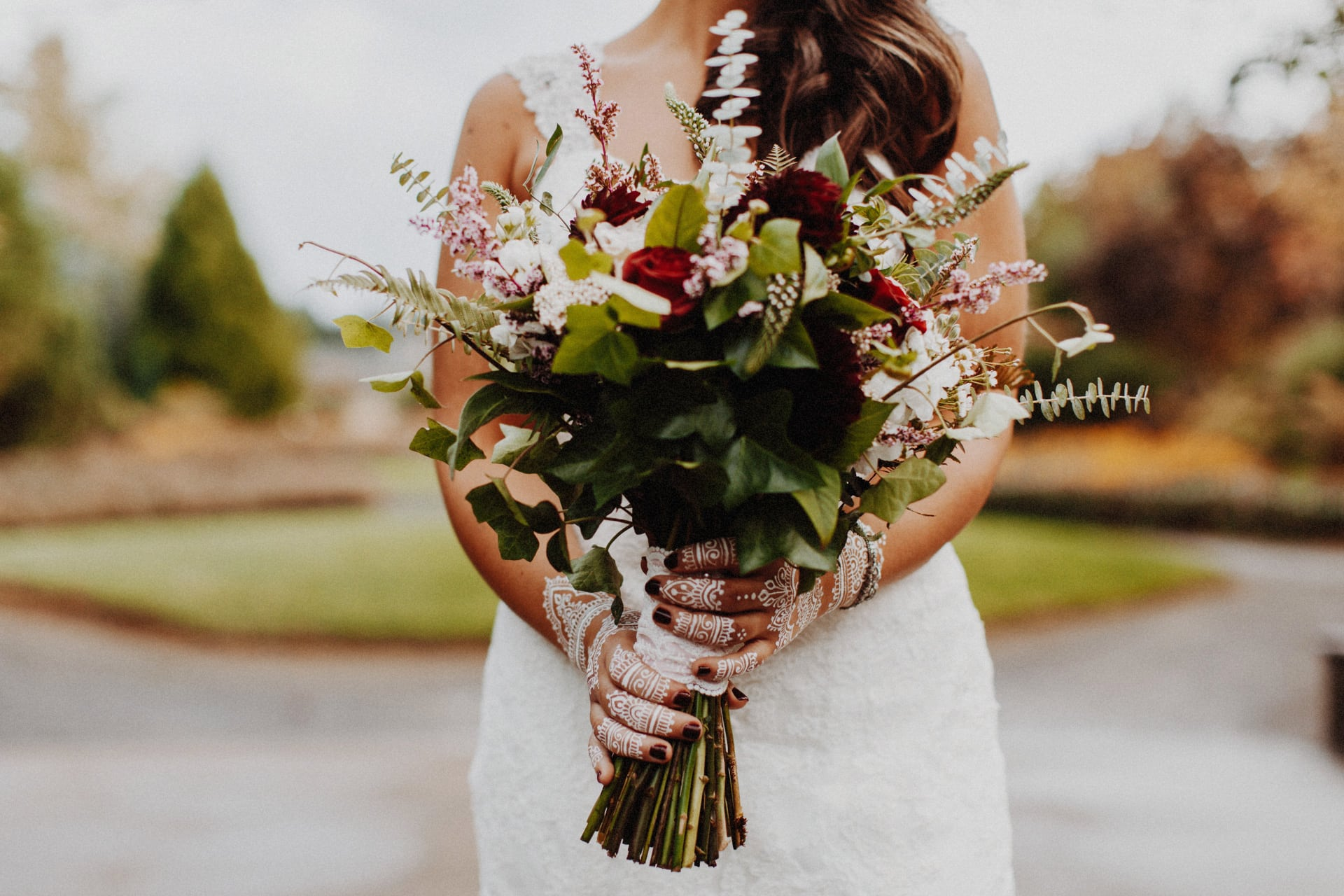 A bride with her bouquet and hena at the Oregon Garden Resort