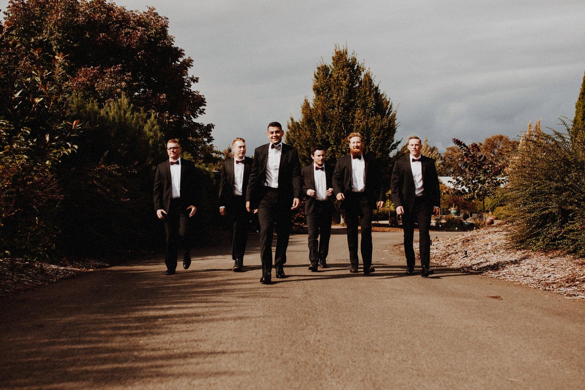 a group of groomsmen walking at the Oregon Garden resort wedding