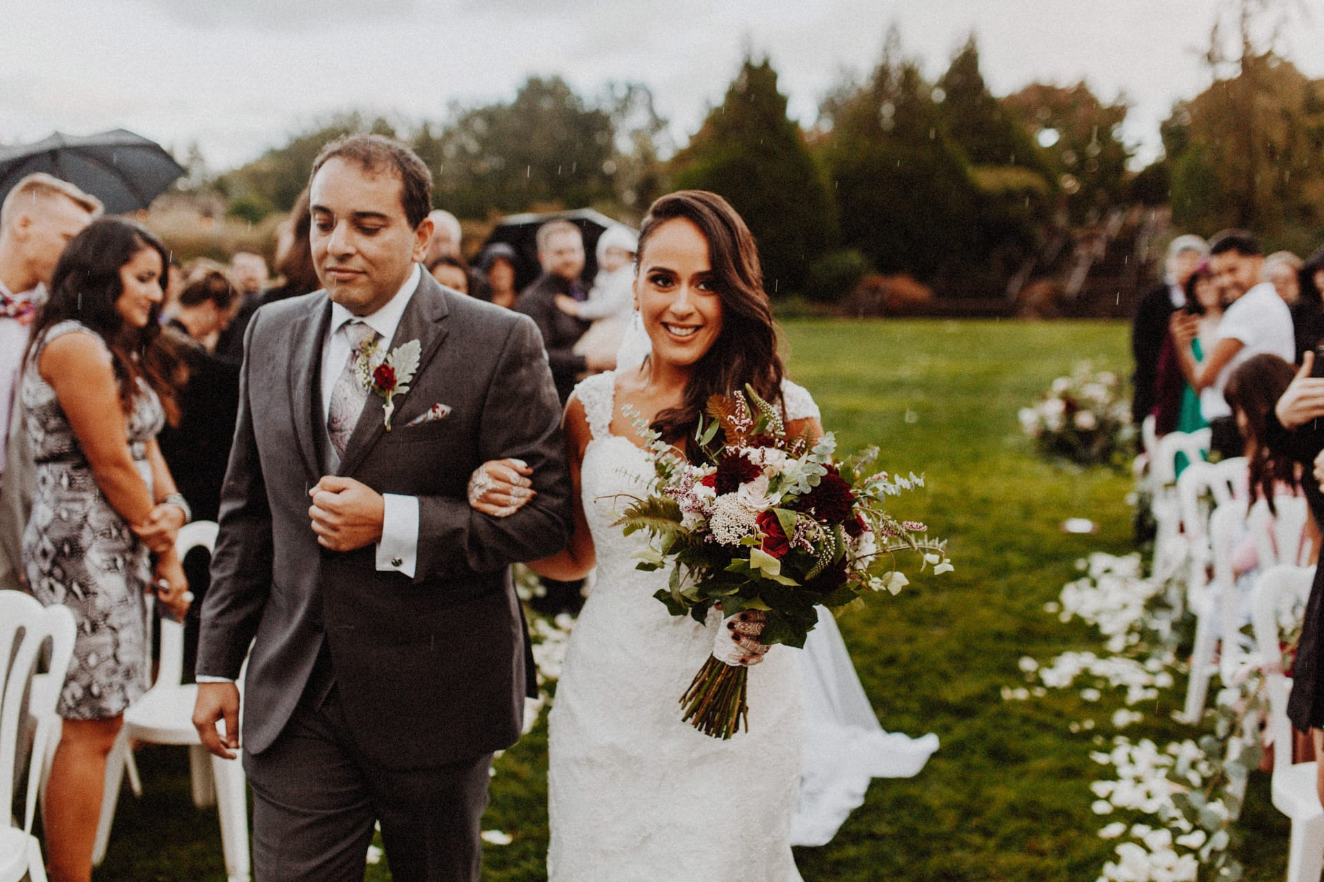 A bride and her father walking down the Aisle at the Oregon Garden Resort