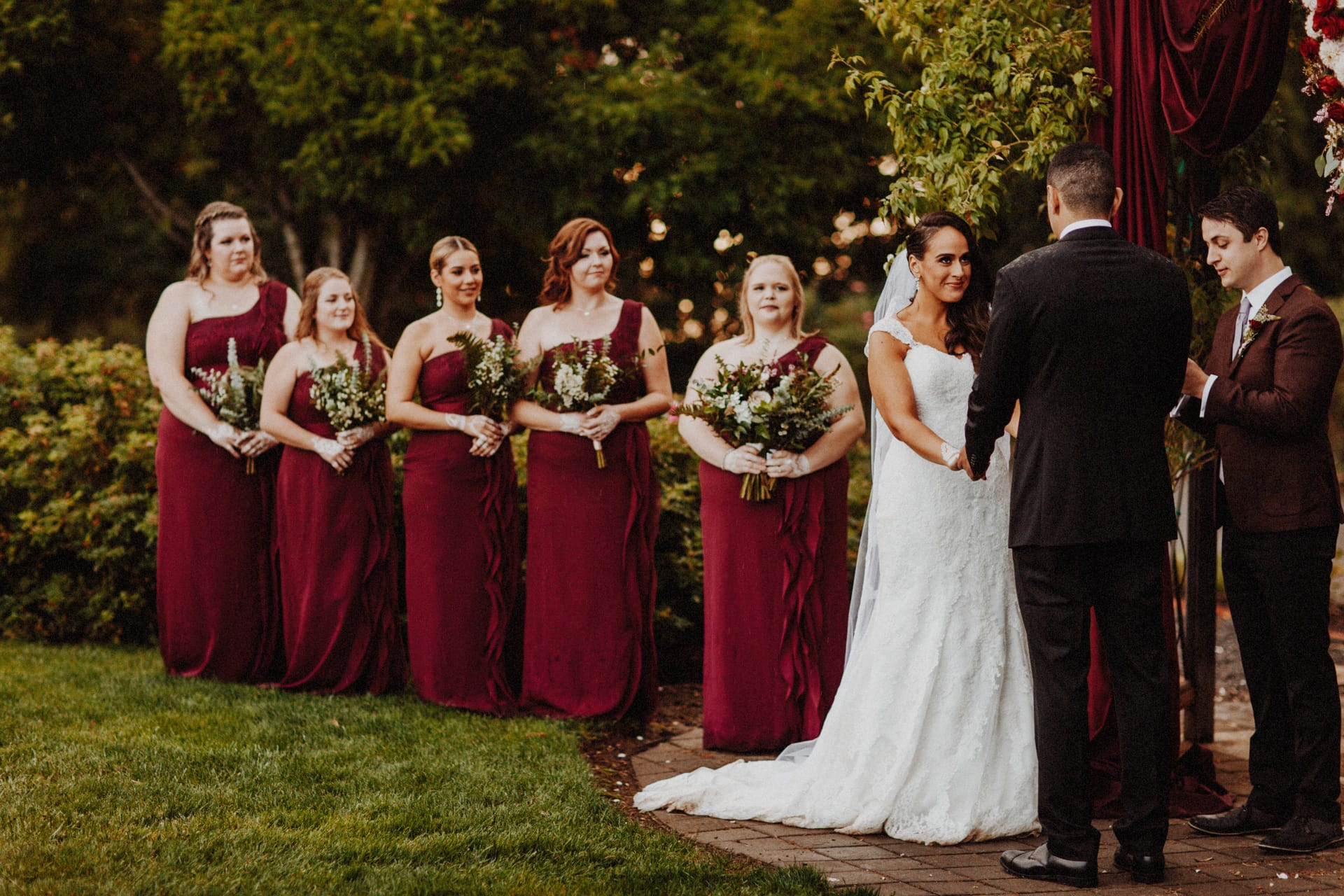 a bride and her bridesmaids dressing in wine colored dresses at the Oregon Garden Resort