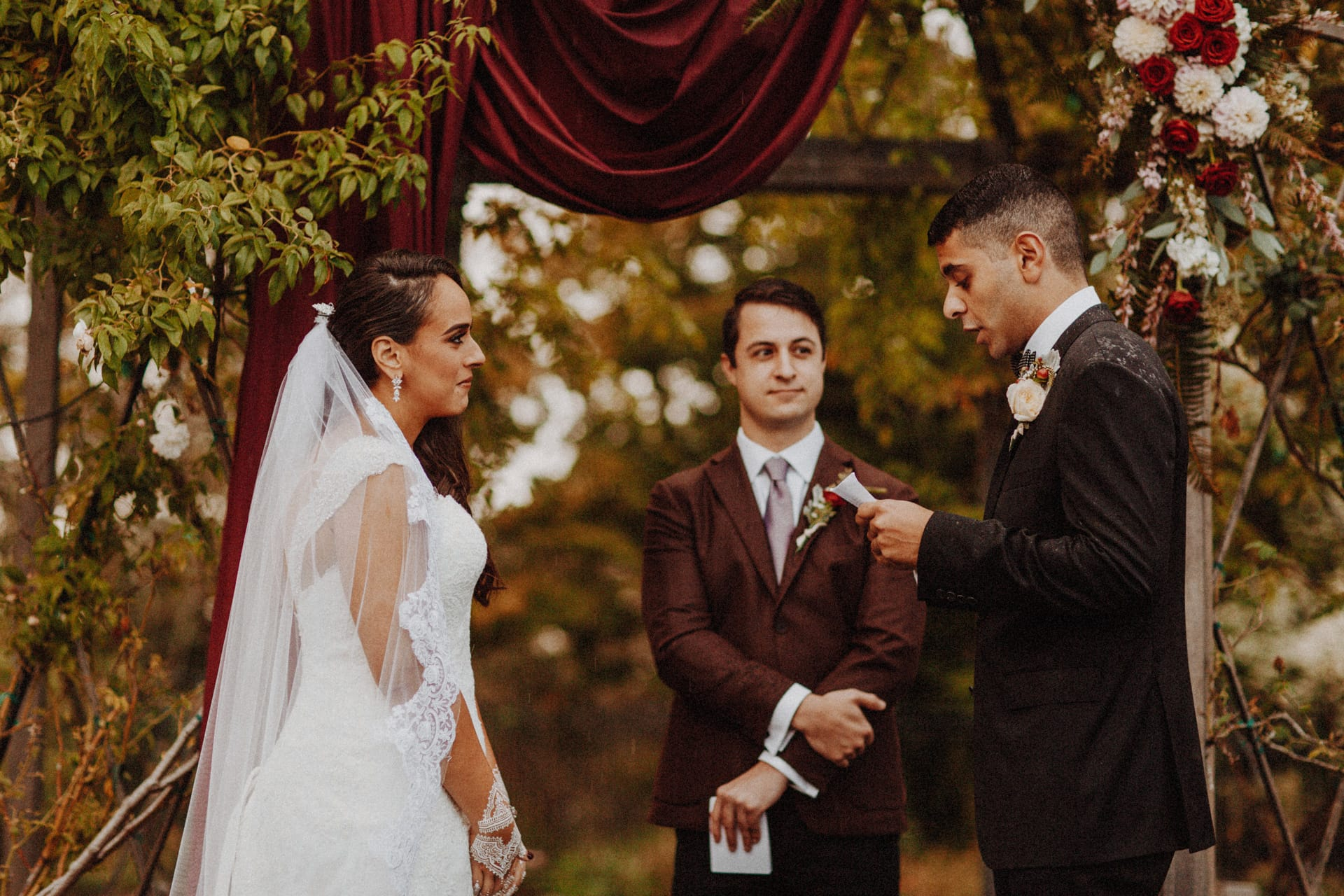 A couple exchanging vows at their ceremony at the Oregon Garden Resort