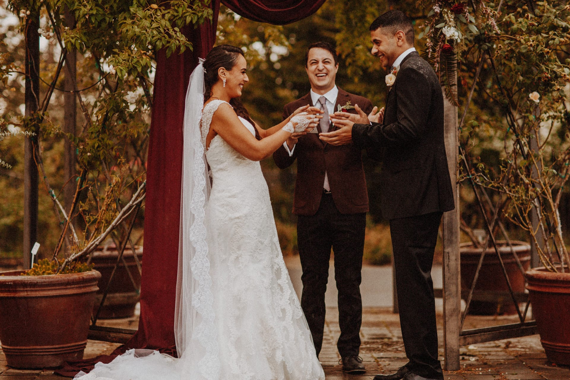 a bride and groom exchanging rings at the Oregon Garden Resort