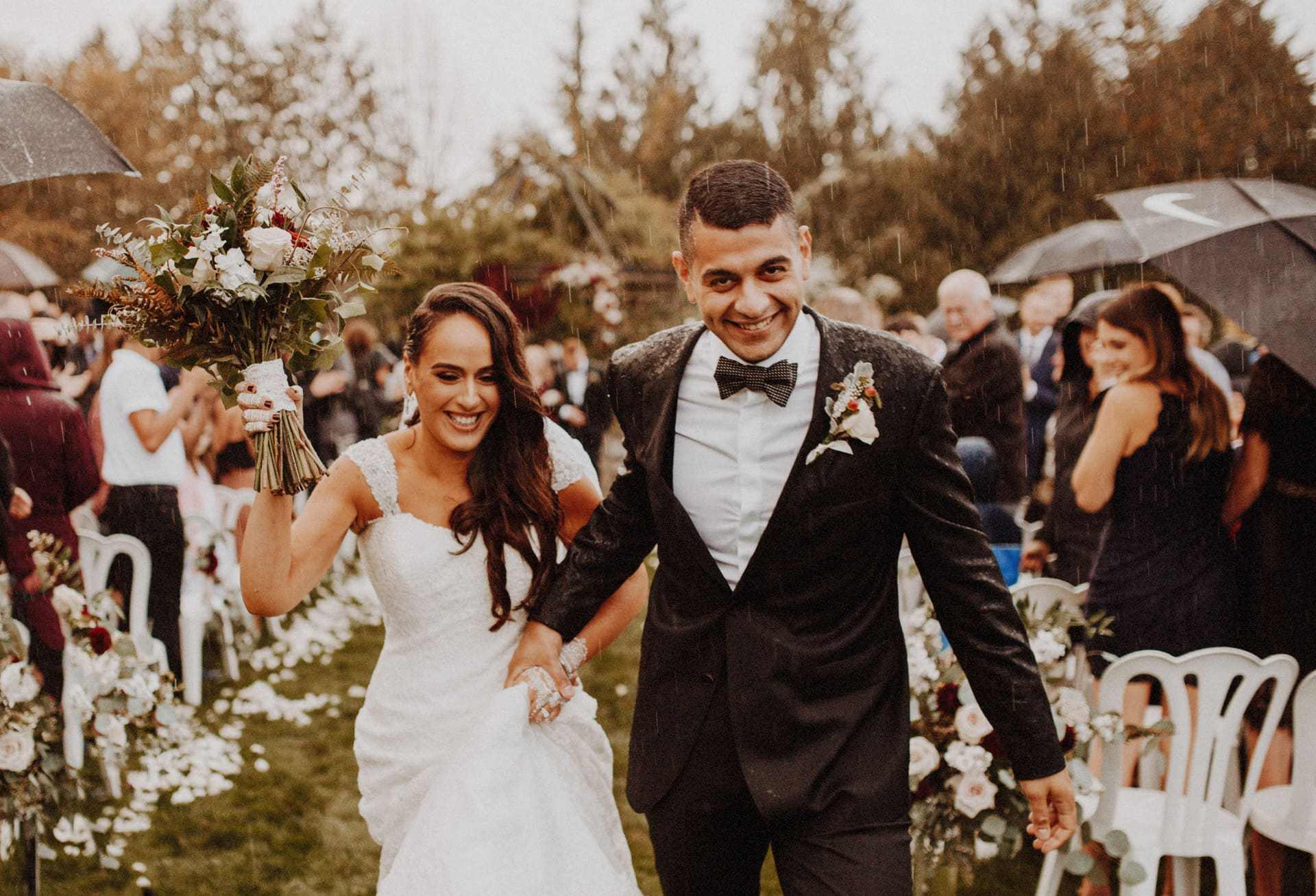 A bride and groom walk down the aisle after getting married at the Oregon Garden Resort