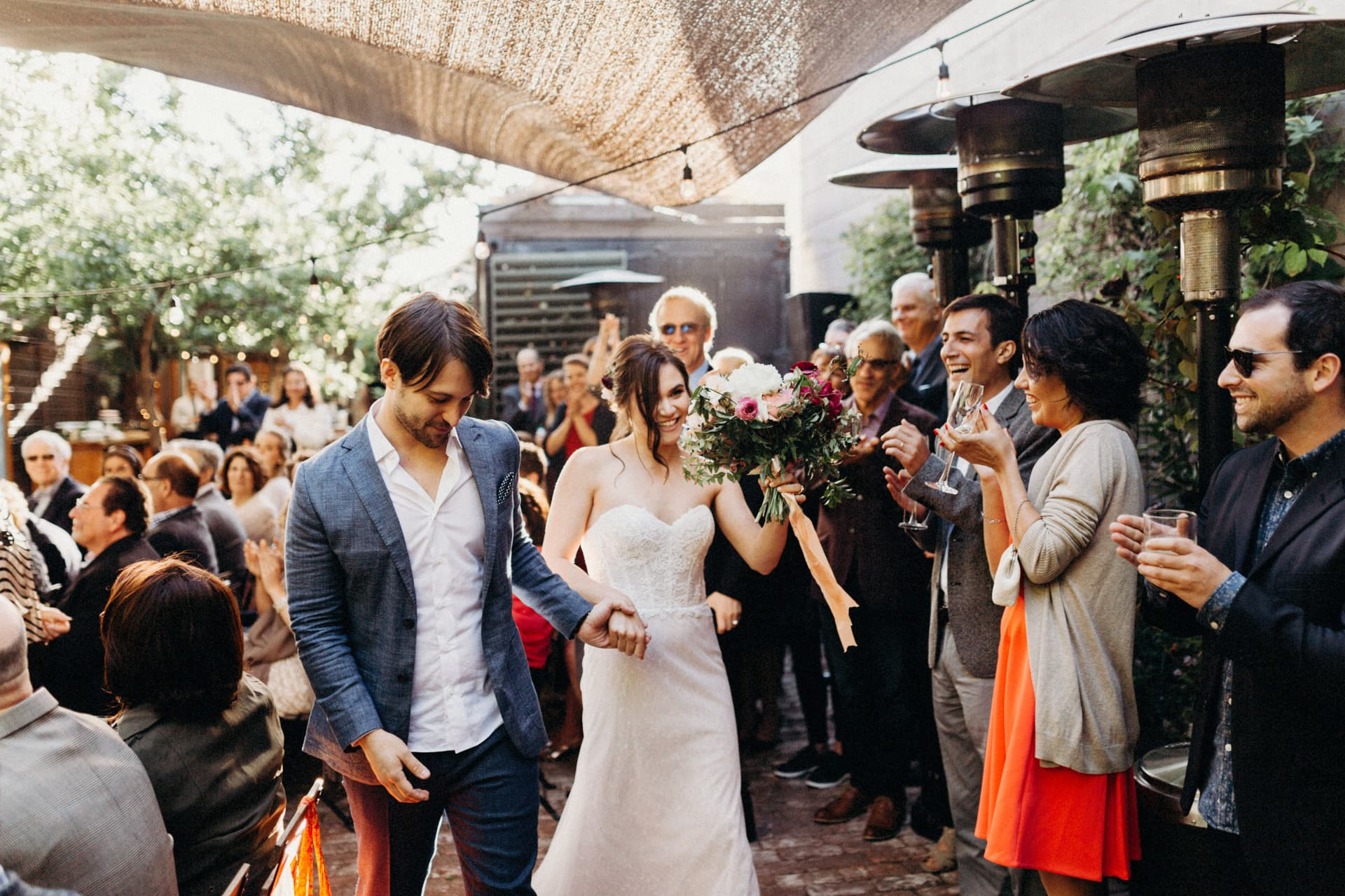 the bride and groom exit the ceremony at the stable cafe wedding in San Francisco
