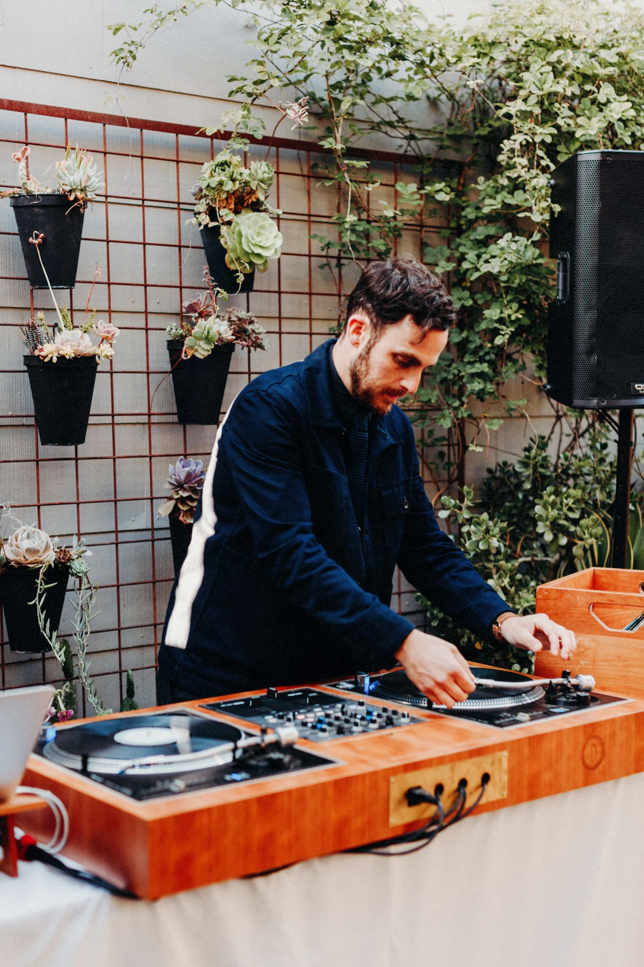 The DJ plays a record at the Stable Cafe Wedding in San Francisco