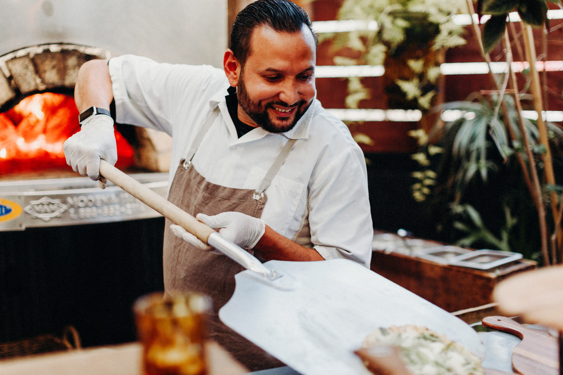 A chef is cooking pizza at the stable cafe in san francisco