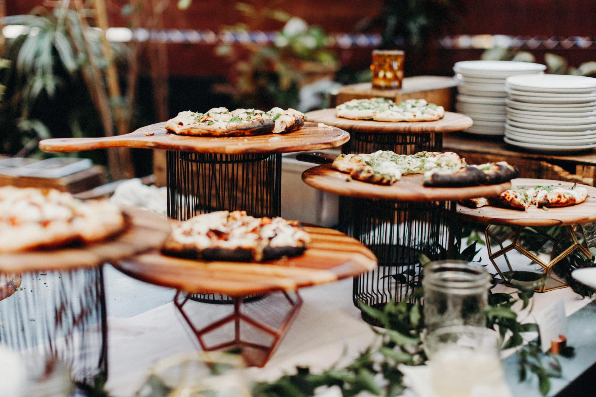 Dinner is served, pizza and cocktails, at the stable cafe wedding