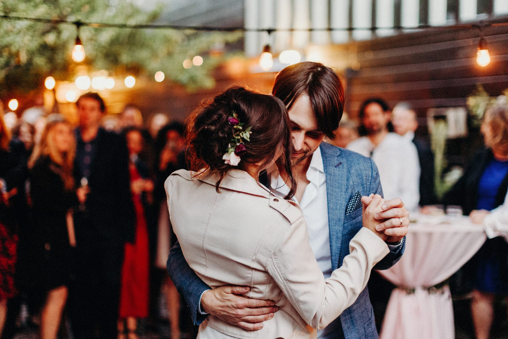 The groom and bride are having their first dance and the Stable Cafe Wedding