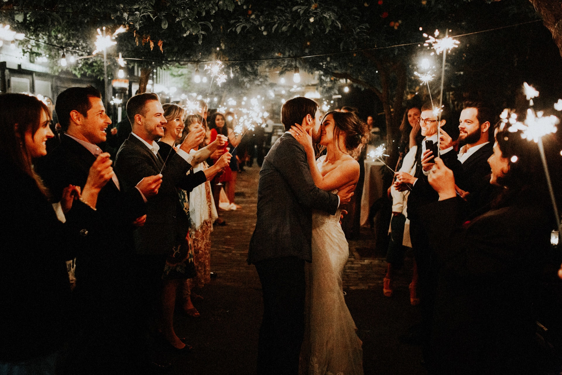 a bride and groom kissing during the sparkler exit at Stable Cafe in San Francisco